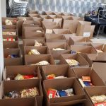 Helping people in need with food for christmas Atlas Sport